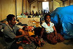 One of the many camps in Dili holding displace people due to the recent violence in East Timor. Peacekeeping forces led by Australia help to secure the capitol Dili.  .070606
