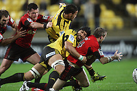 Victor Vito tackles Brent Ward. Super 15 rugby match - Crusaders v Hurricanes at Westpac Stadium, Wellington, New Zealand on Saturday, 18 June 2011. Photo: Dave Lintott / lintottphoto.co.nz