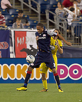 New England Revolution forward Khano Smith (18) attempts to control the ball as Columbus Crew defender Frankie Hejduk (2) defends. The New England Revolution tied Columbus Crew, 2-2, at Gillette Stadium on September 25, 2010.