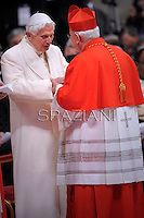 Italian cardinal Gualtiero Bassetti  is congratulated by Pope emeritus Benedict XVI  after he was appointed cardinal by the Pope at the consistory in the St. Peter's Basilica at the Vatican on February 22, 2014.