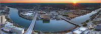 As the sun sets west of Austin, Texas, and the Texas Hill Country, Town Lake (Ladybird Lake) winds through the downtown area. From I-35 to the east to Lamar Bridge to to the west, with Congress and 1st Street Bridges in between, this panorama of Austin shows the view from 54 stories high.