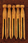 Five clothes pegs