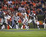 Ole Miss quarterback Randall Mackey (1) looks to pass as Ole Miss' Brandon Bolden (34) blocks vs. Auburn at Jordan-Hare Stadium in Auburn, Ala. on Saturday, October 29, 2011. Auburn won 41-23..