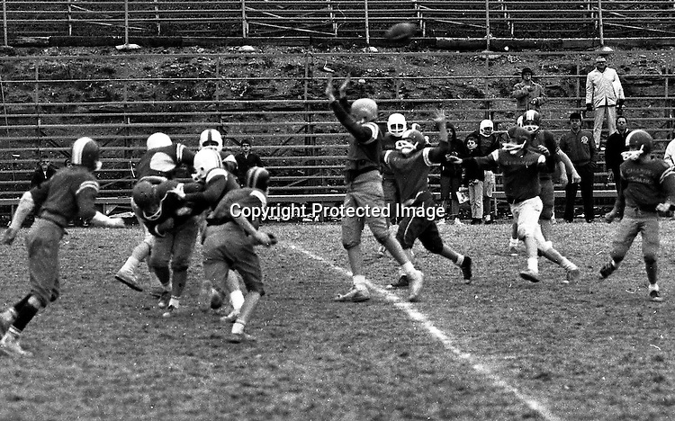 Bethel Park PA:  Bethel Recreation Football League's Chamber of Commerce Football team.  We played all the games at the Senior High Football Field. Big Tony Zimmer putting the pressure on QB Mike Stewart.<br /> Team members include; John Rassmussen, Mike Stewart, Scott Streiner, Fred Griffin, Rick Matthews, Joe Fredley, Bruce Mahoney, Coaches Frank Feeney and Jim Mahoney.  Mr Chris, Director of the Recreation League was also the referee.