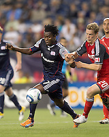 New England Revolution forward Kenny Mansally (7) dribbles as Toronto FC defender Ty Harden (20) pressures. In a Major League Soccer (MLS) match, the New England Revolution tied Toronto FC, 0-0, at Gillette Stadium on June 15, 2011.
