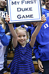 "26 November 2014: A young Duke fan holds up a sign reading ""My First Duke Game"". The Duke University Blue Devils hosted the Furman University Paladins at Cameron Indoor Stadium in Durham, North Carolina in a 2014-16 NCAA Men's Basketball Division I game. Duke won the game 93-54."