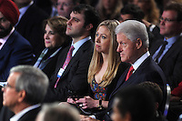Chelsea Clinton and Bill Clinton listen as Egyptian President
