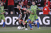 D.C. United forward Hamid Salihi (9) shields the ball against Seattle Sounders defender Patrick Ianni (4) D.C. United tied the Seattle Sounders, 0-0 at RFK Stadium, Saturday April 7, 2012.