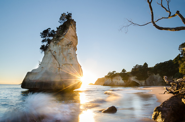 Sunstar behindTe Hoho Rock, Cathedral Cove at sunrise. Coromandel, New Zealand - stock photo, canvas, fine art print
