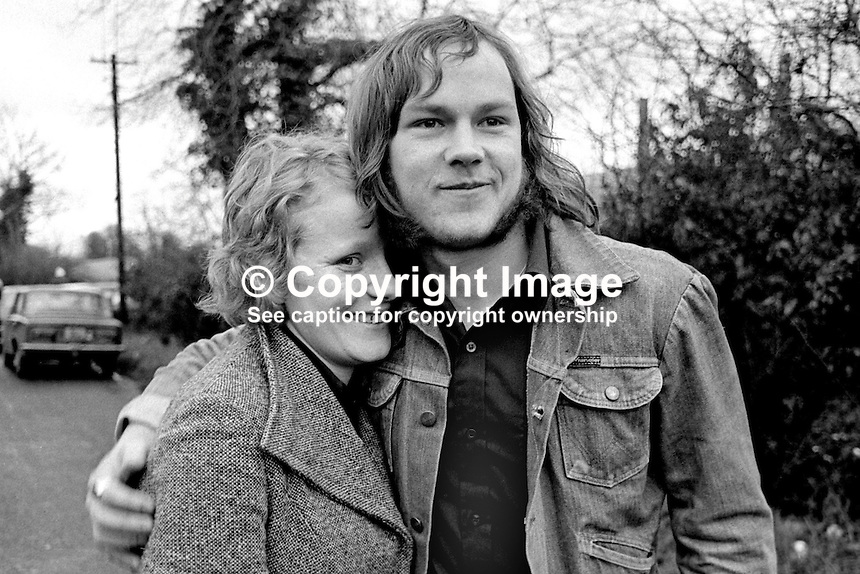 Brian Davidson, 21 years, with his girlfriend, Maureen Colligan, after being released from Long Kesh, near Lisburn, N Ireland, after 2 years 8 months internment. 197501000067. <br /> <br /> Copyright Image from Victor Patterson,<br /> 54 Dorchester Park, Belfast, UK, BT9 6RJ<br /> <br /> t1: +44 28 90661296<br /> t2: +44 28 90022446<br /> m: +44 7802 353836<br /> <br /> e1: victorpatterson@me.com<br /> e2: victorpatterson@gmail.com<br /> <br /> For my Terms and Conditions of Use go to<br /> www.victorpatterson.com