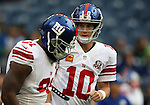 New York Giants quarterback Eli Manning (10) talks to cornerback Zach Bowman (31) before their game against the Seattle Seahawks   at CenturyLink Field in Seattle, Washington on November 9, 2014. The Seahawks  beat the Giants 38-17.  ©2014. Jim Bryant Photo. All rights Reserved.