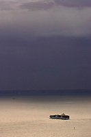 Cargo ship sailing into storm.<br />