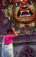 Performing Puja to White Bhairab, Indra Jatra festival.