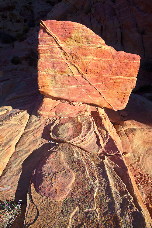 An eroded, multi-colored, striated Aztec Sandstone rock formation in an unnamed canyon in Valley of Fire State Park, Nevada, USA