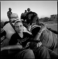 Shirat Hayam, Gaza strip, August 18th, 2005.A group of 38 people, mostly religious teenagers, lead by Noam Arnon, a prominent settler leader from Hebron, tied themselves together on a roof, praying and singing, they were the last settlers to be evacuated from this seaside settlement.