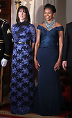 U.S. first lady Michelle Obama (R) and Samantha Cameron (L), wife of British Prime Minister David Cameron, pose for an official photo at the Grand Staircase of the White House March 14, 2012 in Washington, DC. Prime Minister Cameron was on a three-day visit in the U.S. and he had talks with President Obama earlier the day. .Credit: Alex Wong / Pool via CNP