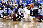 Guard Isaiah Briscoe of the Kentucky Wildcats and Craig Sword fight for the ball during the game against the Mississippi State Bulldogs at Rupp Arena on January 20, 2015 in Lexington, Kentucky. Photo by Taylor Pence