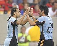 Dwayne De Rosario #17 and Brian Ching #25 of the MLS All-Stars after Dwayne De Rosario #17 had scored during the 2010 MLS All-Star match against Manchester United at Reliant Stadium, on July 28 2010, in Houston, Texas. Manchester United won 5-2.
