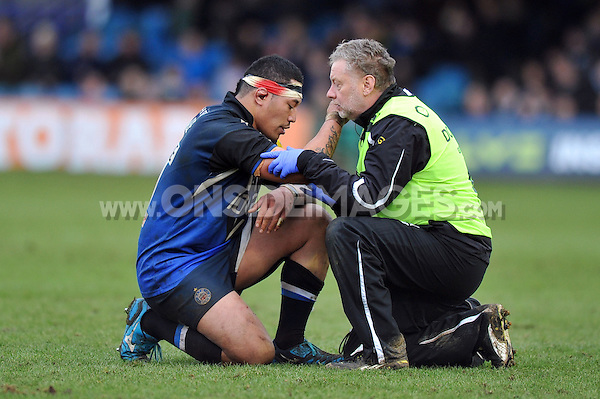 Anthony Perenise is treated for an injury by Dr Julian Widdowson. LV= Cup match, between Bath Rugby and Exeter Chiefs on January 26, 2013 at the Recreation Ground in Bath, England. Photo by: Patrick Khachfe / Onside Images