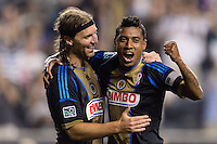 Jose Kleberson (19) of the Philadelphia Union celebrates scoring with Jeff Parke (31). The Philadelphia Union defeated Toronto FC 1-0 during a Major League Soccer (MLS) match at PPL Park in Chester, PA, on October 5, 2013.