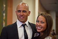 """COOLANGATTA, Australia (Thursday, February 26, 2009) - .2008 World Surfing Champion Kelly Slater (USA) and girlfriend Kalani Millar (USA)   at the ASP World Champions' Crowning took place tonight at the Gold Coast Convention and Exhibition Centre beginning at 6:30pm.. .Surfing's """"night of nights"""", the ASP World Champions' Crowning, was a gala event, hosting the world's best surfers as well as distinguished figures from the surfing industry in honor of the 2008 ASP World Champions.. .Kelly Slater (USA), 36, reigning and nine-time ASP World Champion, accepted his unprecedented ninth ASP World Title award just days before beginning his hunt for an incredible 10th Crown at the upcoming Quiksilver Pro Gold Coast presented by LG Mobile.. .Stephanie Gilmore (AUS), 21, reigning two-time ASP Women's World Champion, received her second consecutive ASP Women's World Title cup, and the young natural-footer will soon embark on a campaign to make it a three-peat in 2009. Gilmore will begin this weekend at the opening event of the 2009 ASP Women's World Tour season, the Roxy Pro Gold Coast presented by LG Mobile.. .Other ASP Dream Tour athletes  recognized were respective Runner-Ups Bede Durbidge (AUS), 25, and Silvana Lima (BRA), 24, as well as Rookies of the Year Dane Reynolds (USA), 23, and Nicola Atherton (AUS), 22.. .Bonga Perkins (HAW), 36, and Joy Monahan (HAW), 22, took out the ASP World Longboarding and ASP Women's World Longboarding Titles respectively, while Nathaniel Curran (USA), 24, and Sally Fitzgibbons (AUS), 18, took home hardware for their respective No. 1 finishes on the ASP World Qualifying Series last season.. .In addition to honoring the champions from 2008, the ASP World Champions' Crowning also recognized athletes who  earnt the 2008 ASP World Tour 'Most Improved',  a tie between Adrian Buchan (AUS) and Adrian de Souz (BRA) the 2008 ASP Women's World Tour 'Most Improved', the ASP Service to the Sport Award and the prestigious Peter Whittaker Award take out"""