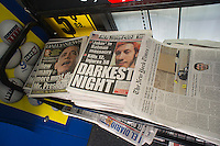 "New York daily newspapers, seen on Saturday, July 21, 2012, report on the mass shooting during the screening of ""The Dark Knight Rises"" in a theater in Aurora, Colorado, allegedly by 24 year old James Holmes. Twelve people were killed and 58 injured. (© Richard B. Levine)"