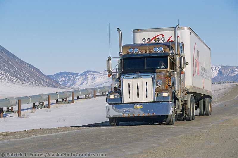 Truck on the James Dalton Highway (haul road) transports goods to Prudhoe bay, Philip Smith mountains of the Brooks range, Arctic, Alaska, Trans Alaska Oil Pipeline.