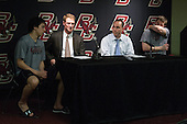 Johnny Gaudreau (BC - 13), Greg Brown (BC - Associate Head Coach), Mike Cavanaugh (BC - Associate Head Coach), Pat Mullane (BC - 11) - The Boston College Eagles defeated the visiting University of New Hampshire Wildcats 5-2 on Friday, January 11, 2013, at Kelley Rink in Conte Forum in Chestnut Hill, Massachusetts.