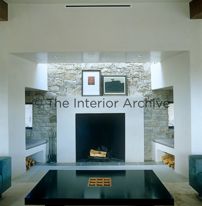 A pleasing symmetry pervades in the arrangement of this living room where the walls are constructed from quarried Telluride stone