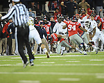 Ole Miss linebacker Denzel Nkemdiche (4) intercepts vs. Mississippi State at Vaught-Hemingway Stadium in Oxford, Miss. on Saturday, November 24, 2012. Ole Miss won 41-24.