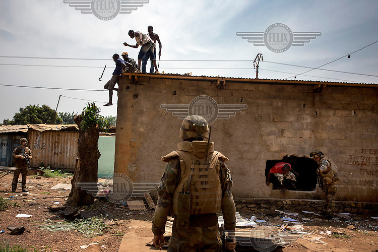 French peacekeepers confront a group of men looting houses belonging to Muslims who fled the capital. In 2013 a rebellion by a predominantly Muslim rebel group Seleka, led by Michel Djotodia, toppled the government of President Francios Bozize. Djotodia declared that Seleka would be disbanded but as law and order collapsed the ex-Seleka fighters roamed the country committing atrocities against the civilian population. In response a vigillante group, calling themselves Anti-Balaka (Anti-Machete), sought to defend their lives and property but they then began to take reprisals against the Muslim population and the conflict became increasingly sectarian. French and Chadian peacekeeping forces have struggled to contain the situation and the smaller Muslim population began to flee the country.