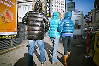Tourists wearing puffy jackets, popular at Uniqlo, Old Navy and other retailers in New York on Thursday, December 29, 2011. (© Richard B. Levine)