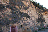 Underground houses near Sefrou, Morocco, with doors cut into the side of a cliff