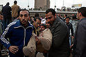 A wounded Anti-Hosni Mubarak protester is taken to a nearby field hospital after being injured in fighting with Mubarak supporters near Tahrir square area February 03, 2011  in Cairo, Egypt. Protesters from both sides clashed throughout the day, throwing rocks and fighting at close range. . .Photo by Scott Nelson