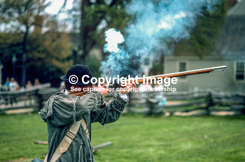 "One of the ""residents"" in period custume in the Colonial Williamsburg Historic Area, the restored capital of 18th century Virginia, fires a flint-lock rifle. 19880505CW2..Copyright Image from Victor Patterson, 54 Dorchester Park, Belfast, UK, BT9 6RJ..Tel: +44 28 9066 1296.Mob: +44 7802 353836.Voicemail +44 20 8816 7153.Skype: victorpattersonbelfast.Email: victorpatterson@me.com.Email: victorpatterson@ireland.com (back-up)..IMPORTANT: If you wish to use this image or any other of my images please go to www.victorpatterson.com and click on the Terms & Conditions. Then contact me by email or phone with the reference number(s) of the image(s) concerned."