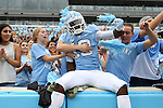 12 September 2015: UNC's Kedrick Davis jumps into the stands before the game. The University of North Carolina Tar Heels hosted the North Carolina A&T State University Aggies at Kenan Memorial Stadium in Chapel Hill, North Carolina in a 2015 NCAA Division I College Football game.
