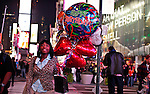 NewYork, United States, October 07, 2011..A woman walks in Times Square in central Manhattan New York October 7, 2011. VIEWpress / Kena Betancur. .On the 20th day of the &ldquo;Occupy Wall Street&rdquo; protest, Mayor Michael Bloomberg weighed in on the movement. He mostly criticized the group and said their actions are hurting the economy and tourism sector..Local Media Report.