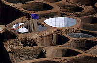 Man working in a tannery, Fes, Morocco.