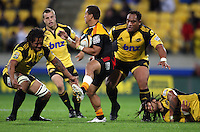 Chiefs fullback Tim Nanai-Williams skips out of the tackle of Ma'a nonu (right) as Rodney So'oialo and Neemia Tialata line him up during the Super 14 rugby match between the Hurricanes and Chiefs at Westpac Stadium, Wellington, NewZealand on Saturday, 1 May 2010. Photo: Dave Lintott / lintottphoto.co.nz