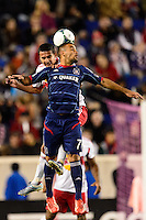 Alex (71) of the Chicago Fire goes up for a header with Tim Cahill (17) of the New York Red Bulls. The New York Red Bulls defeated the Chicago Fire 5-2 during a Major League Soccer (MLS) match at Red Bull Arena in Harrison, NJ, on October 27, 2013.