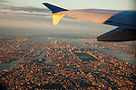 NEW YORK, NY -- AUGUST 13, 2015:  The wing tip of an Airbus A319 flies over New York City, early Thursday morning, August 13, 2015.  PHOTOGRAPH BY MICHAEL NAGLE