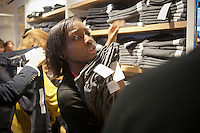 Employees stock jeans at the grand opening of the Uniqlo Flagship store on Fifth Avenue in New York on Friday, October 14, 2011.  The store is a staggering 89,000 square feet on multiple levels and is Fast Retailing's second store in the United States with a third opening next week in the Herald Square shopping district. The largest store on Fifth Avenue filled to the brim with affordable clothing it competes with stalwarts such as the Gap and Zara which are in the immediate proximity. Fast Retailing plans on opening 200 to 300 stores worldwide until 2020 and currently has 1000 stores. (© Richard B. Levine)