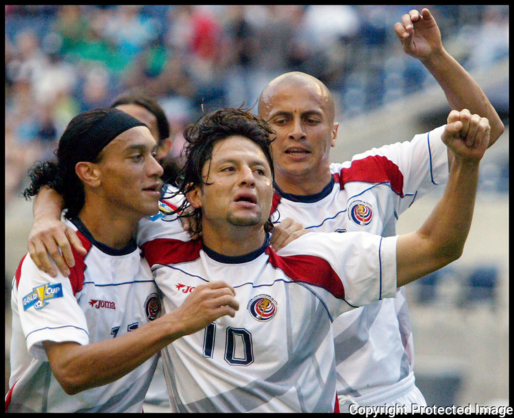 Costa Rica's Jafet Soto (10) is congratulated by teammates Christian Bolanos, left, and  Dany Fonseca ,right,  after Soto scored a first half goal on a pentalty kick against Canada in a CONCACAF Gold Cup game Thursday, July 7, 2005 in Seattle. (AP PHOTO/Jim Bryant)