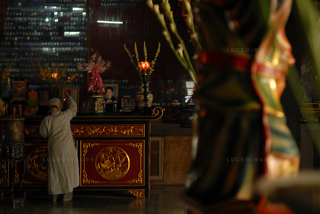 A woman prays in a pagoda in Ho Chi Minh City, Vietnam
