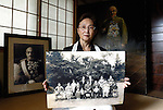 """Yuko Tojo, granddaughter of Japan's wartime leader, General Hideki Tojo, poses with a family photo taken with her grandfather when she was 2 at her home in Tokyo. Gen. Hideki Tojo - who ordered the attack on Pearl Harbor -- was charged and hanged as a war criminal after World War II when Yuko was just 6, and he is enshrined inside the controversial Yasukuni Shrine together with 13 other convicted war criminals. Though she remembers little of her grandfather she still regards him as a hero. """"Japan did not fight a war of aggression but in self-defense,"""" says Ms. Tojo, widely seen as a leading figurehead in a recent surge in nationalism in Japan and who unsuccessfully ran for a seat in Japan's House of Councilors in 2007. """"Schoolchildren are told what evil things our country and their ancestors did during the war and this has led to a lack of pride in the Japanese people. This is wrong. We must reinstall a sense of pride and confidence in our children."""" Upon running for a seat in Japan's Upper House of Parliament, one of her main goals was to ensure all of Japan's war dead would be enshrined at the central Tokyo shrine."""