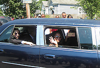 LOUISVILLE, KY - JUNE 10: Friends and family of Muhammad Ali shake hands with people in the crowd lining Grand Avenue as the funeral procession motorcade drives in front Ali's childhood home on June 10, 2016 in Louisville, Kentucky. (Photo by VIEWpress/Teddy Blackburn)