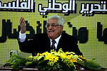 Palestinian President Mahmud Abbas delivers a speech to Fatah members in the west Bank city of Ramallah on 31 December 2009, on the eve of the party's 45th anniversary of its armed struggle. The secular Fatah movement led by Abbas vowed to step up its struggle against the Israeli occupation with demonstrations and diplomacy. Photo by Issam Rimawi