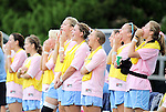 "25 September 2011: UNC players on the bench yell out, ""Tar"" prompting fans in the stands (not pictured) to respond with ""Heels"". The University of Virginia Cavaliers defeated the University of North Carolina Tar Heels 1-0 in overtime at Fetzer Field in Chapel Hill, North Carolina in an NCAA Division I Women's Soccer game. UNC players wore special pink jerseys for the game to be auctioned off as part of a fundraiser for the UNC Lineberger Comprehensive Cancer Center."