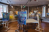 Paintings fill the ground floor of the stone tower at Glen Echo Park, Maryland.
