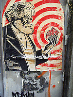 "Switzerland. Geneva. A poster on a wall from Karl Heinrich Marx, holding a heart in his left hand. Graffiti. Karl Heinrich Marx (May 5, 1818 - March 14, 1883) was a German philosopher, political economist, historian, political theorist, sociologist, communist, and revolutionary, whose ideas played a significant role in the development of modern communism. Marx argued that capitalism, like previous socioeconomic systems, would inevitably produce internal tensions which would lead to its destruction. Just as capitalism replaced feudalism, he believed socialism would, in its turn, replace capitalism, and lead to a stateless, classless society called pure communism. This would emerge after a transitional period called the ""dictatorship of the proletariat"": a period sometimes referred to as the ""workers state"" or ""workers' democracy"" . 28.11.09  © 2009 Didier Ruef"